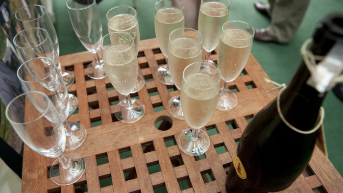 Flutes of champagne on a table.