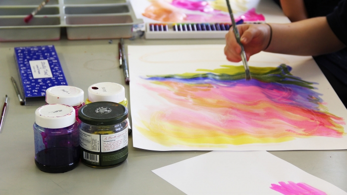 A student paints during a workshop for the academy prospectus.