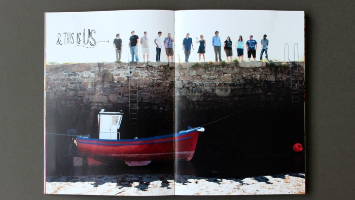 A double spread of the Nixon team standing on Hayle harbour.