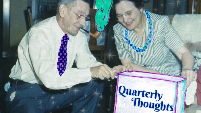 A man, who's smoking a pipe, and a woman looking at a box on which 'Quarterly Thoughts' is written.