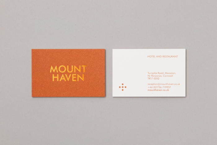The orange front and white back of the Mount Haven Hotel business card.