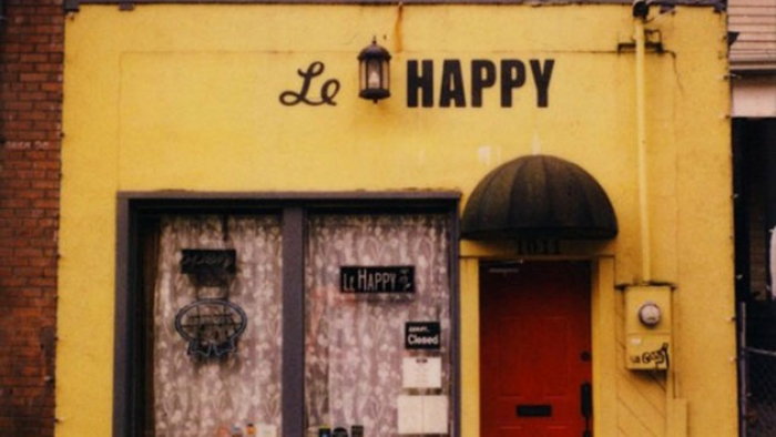 An old shop with a sign reading 'Le Happy'.