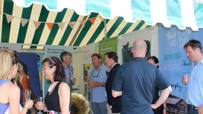 People talking in the Nixon tent at Royal Cornwall Show.
