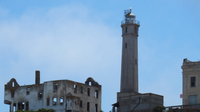 The ruins of a building and a still-standing lighthouse.