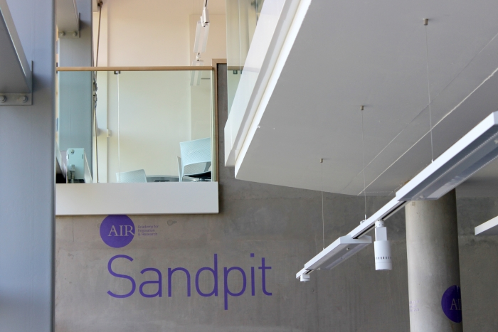 The word 'Sandpit' painted on a concrete wall – part of Falmouth University's signage.