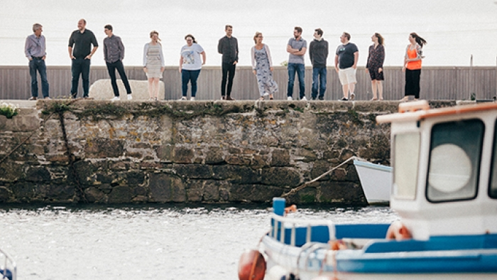 The Nixon team by the water in Hayle