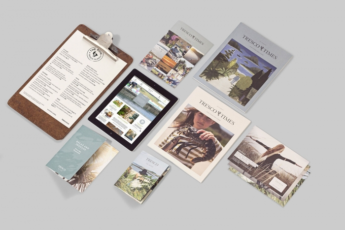 A group of printed materials for Tresco Island, including leaflets, magazines and a menu clipboard, designed by Nixon Design.