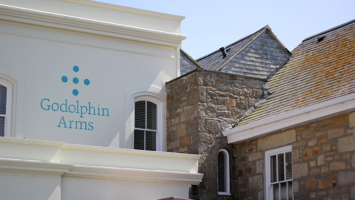 The Godolphin Arms logo painted on the side of a building.