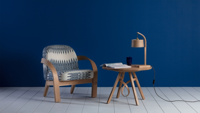 Tom Raffield products: an armchair, a table and a lamp.
