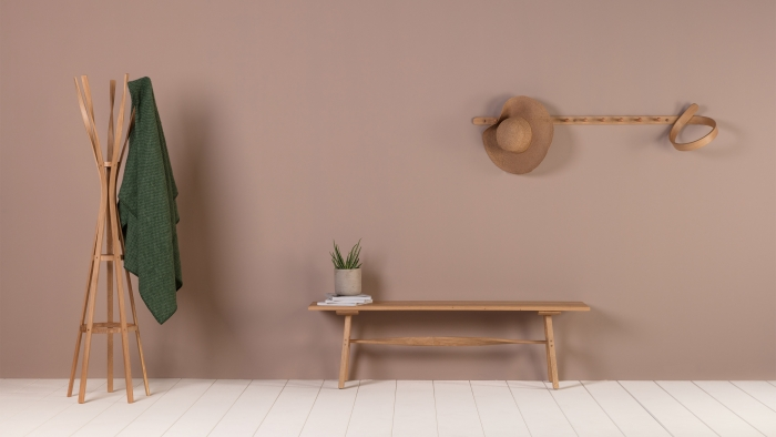Tom Raffield products: a coat stand, a bench and coat hooks.