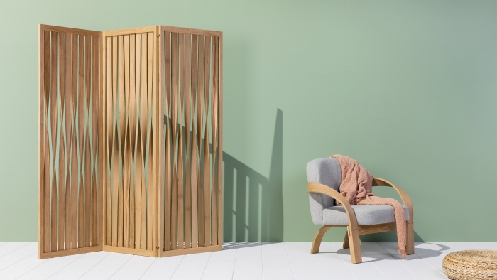 Tom Raffield products: a room-dividing screen and an armchair.