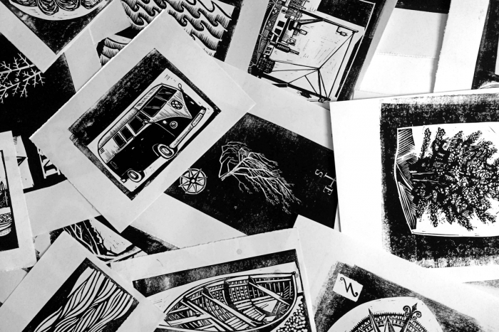 Sheets of linocut illustration prints.