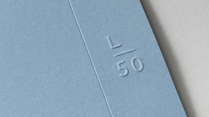 Latitude50's shortened 'L 50' logo, embossed on card.