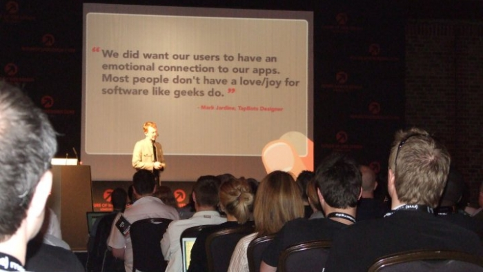 A man delivering a speech at a digital conference.