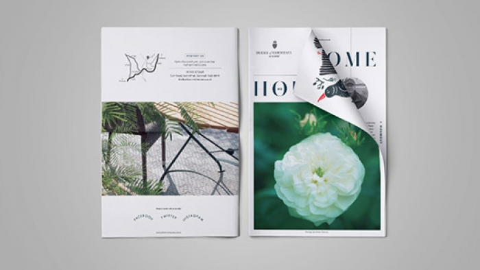 The front and back covers of Houmout – a brand newspaper.