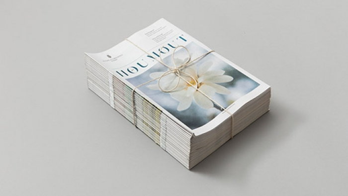 A stack of editions of Houmout – a brand newspaper by Nixon Design.