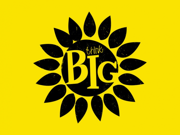A sunflower icon with 'Think big' typed inside it.