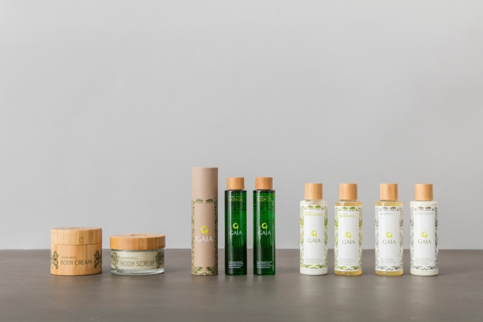 Gaia Spa beauty products, including tubs of moisturiser and bottles of bath oil.