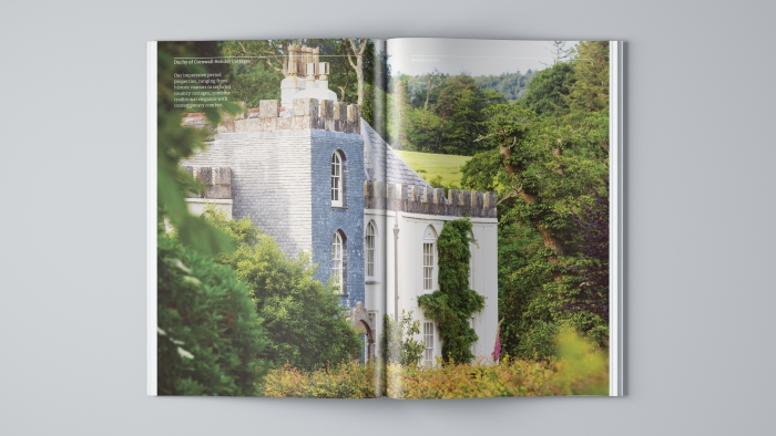 A double-page spread in the Duchy of Cornwall Holiday Cottages brochure showing Restormel Manor.