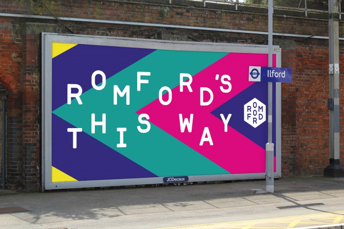 A mocked-up billboard reading 'Romford this way'.