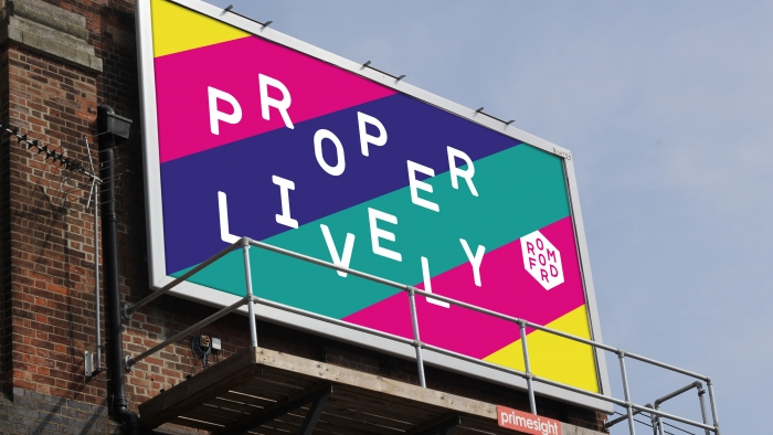 A mocked-up billboard reading 'Proper lively'.