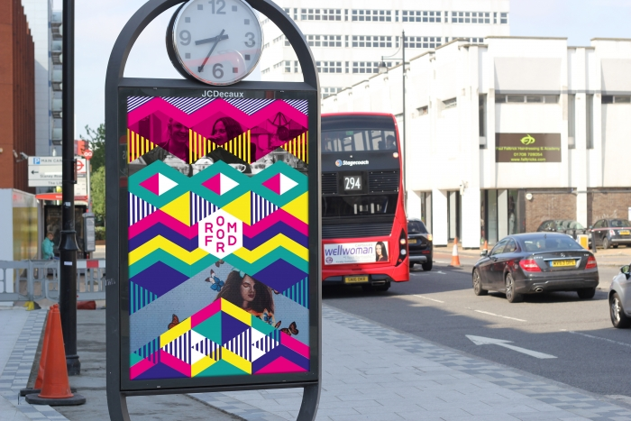 A mocked-up advertising hoarding in Romford, with a colourful geometric pattern.