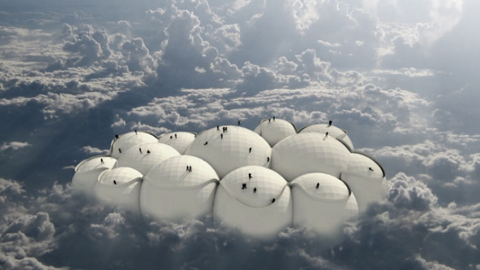 A large structure of spheres protruding through cloud with people walking on it.