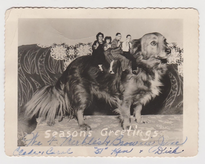 An old photographic collage showing a family riding a dog with the message 'Season's greetings' handwritten on it.