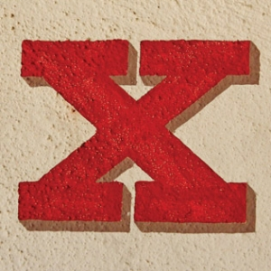 The letter X painted on stone.