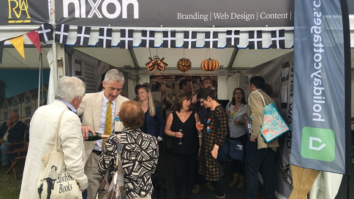 Martin Nixon pours champagne outside the Nixon Design stand at Royal Cornwall Show.