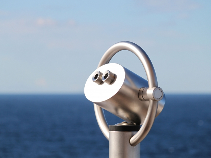 Pair of fixed binoculars pointing out to sea