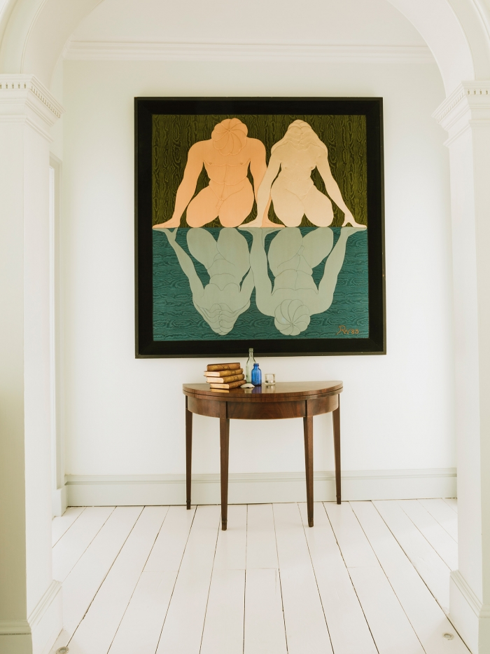 A large painting hung above a semi-circular table in Chapel House, Penzance.