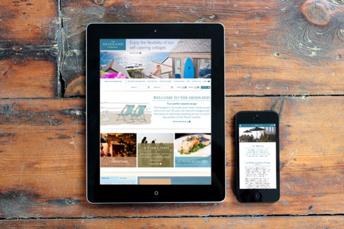 An iPad and an iPhone with the Headland Hotel website loaded.