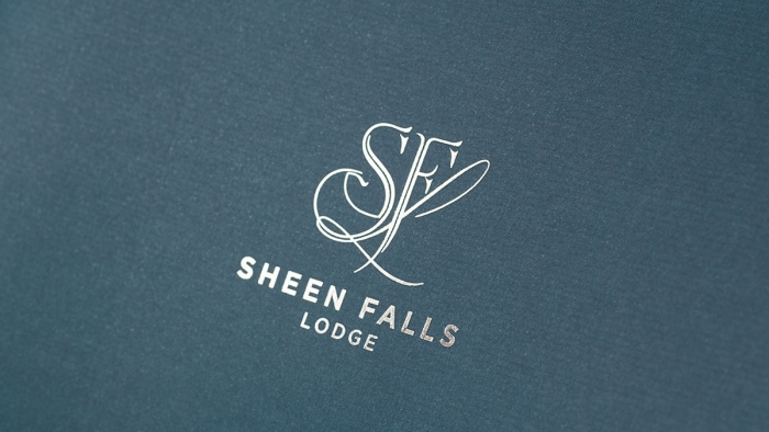 The Sheen Falls Lodge logo in silver foil on the cover of their brochure.