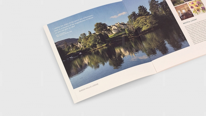 An image of Sheen Falls Hotel by the lake in their brochure.