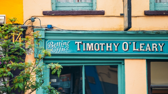 A shop with a painted sign reading 'Timothy O'Leary'.