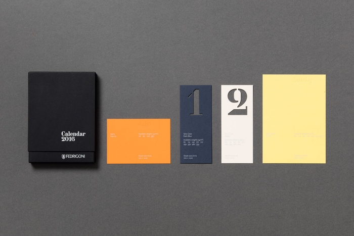 Different elements of the Fedrigoni paper calendar lined up: the box, the month, the date and the day.