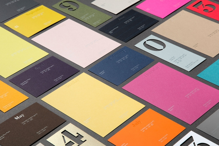 A range of different paper stocks from the Fedrigoni calendar laid out.