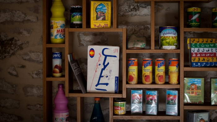 A selection of branded products from around the world displayed on a bookshelf.